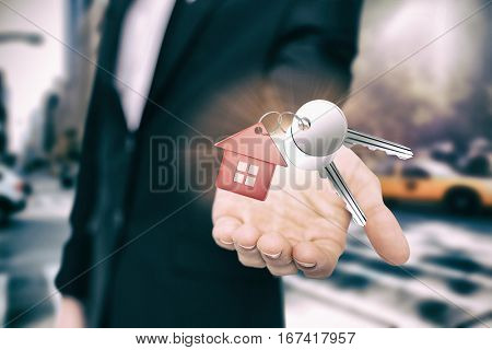Metal keys with red home ring against new york street