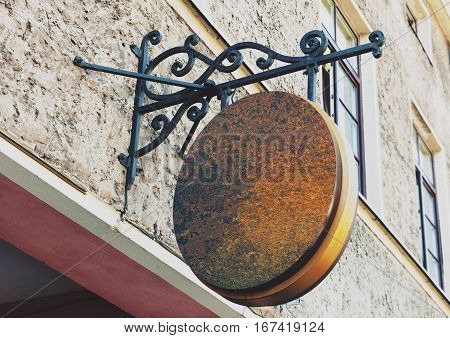Blank rounded and rusty outdoor business signage mock up to add company logo