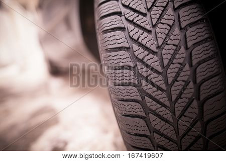 Close up shot of a car's winter tire.