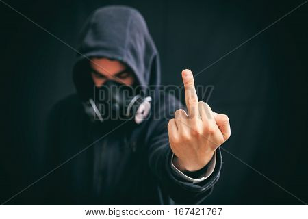 Hooded Man Making A Gesture On Black Background