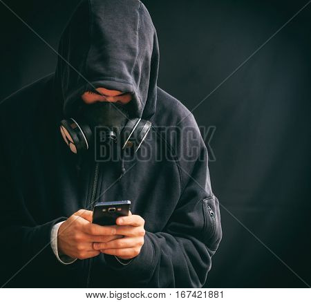Hooded Man Holding A Smartphone