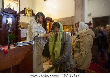 PORTO, PORTUGAL - JAN 19, 2017: During celebrating Baptism of Jesus in the Parish of Russian Orthodox Church. This is one of the holiest holidays for all Christians.