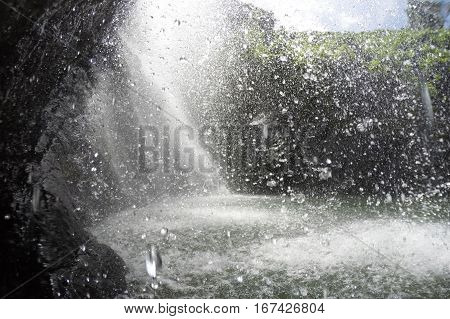 Water Drops Fall From Behind A Waterfall