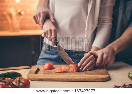 Cropped image of beautiful couple cooking together in the kitchen