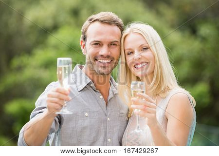 Portrait of smiling couple holding champagne flutes