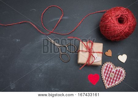 Handmade Gift And Heart On Blackboard. Valentines Day