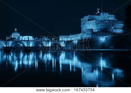 Castel Sant Angelo in Italy Rome at night over Tiber River with reflection