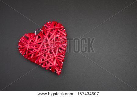 Red Wicker Rattan Heart On Black Chalkboard. Valentines Day.