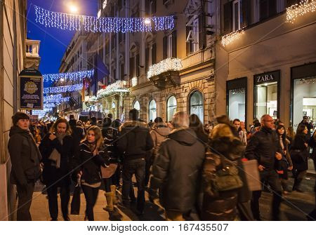 People On Shopping Street In Rome City In Night