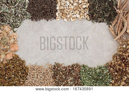 Herbs to heal anxiety and sleeping disorders forming a background border on natural hemp paper.