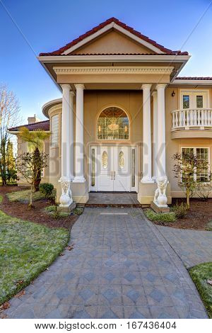 Mediterranean Style Waterfront Home With Columned Porch