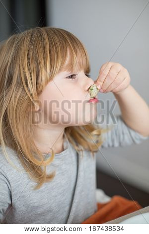 Little Child Sucking A Clam