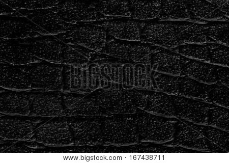 The black leatherette texture background for design .