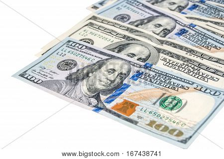 Heap of 100 dollar bills on the right side isolated on white background. Business concept
