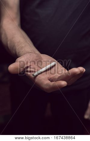 Closeup of cigarette in male hands. Bad habits concept.