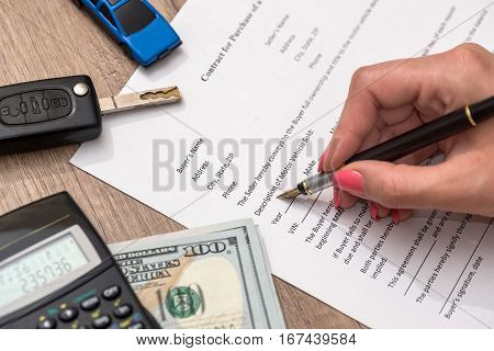 car contract form with money pen key