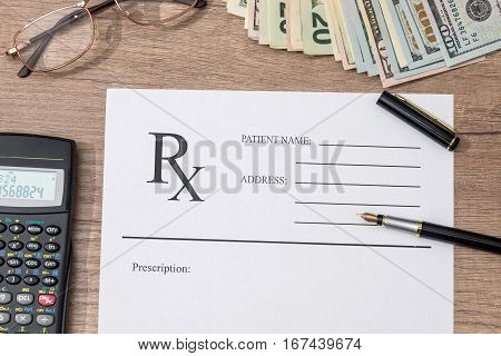 rx form with pen and calculator on table