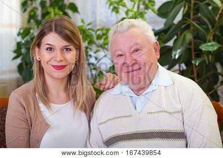 Picture of a happy elderly man with his granddaughter
