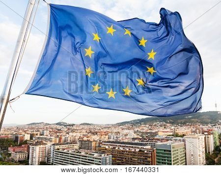 Eu Flag Flutters Over Houses In Barcelona City