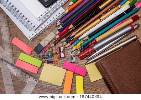different school supplies on a wooden table