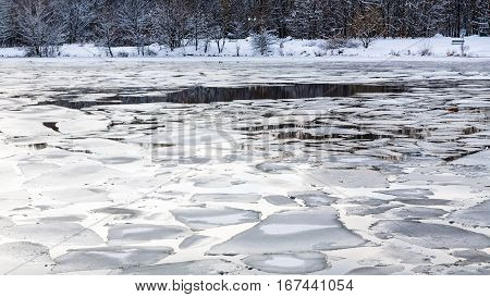 Melting Ice Blocks On Surface Of River