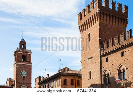 Clock Tower And Tower Of City Hall In Ferrara City