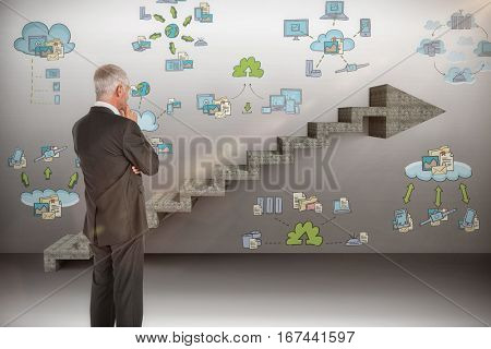 Thoughtful businessman standing back to camera against composite image of steps moving up