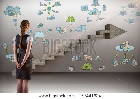 Redhead businesswoman with hands behind back against composite image of steps moving up