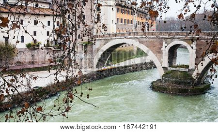 Tiber River And Bridge To Isola Tiberina