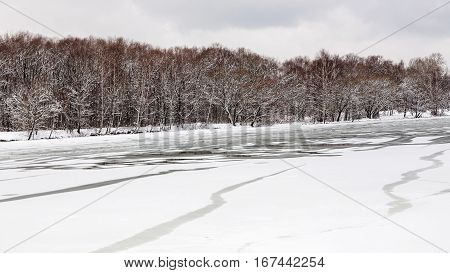 spring season - melting ice surface of frozen river