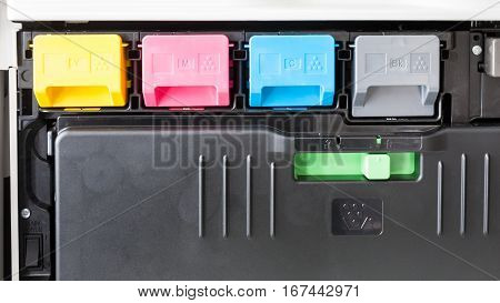 four color toner cartridges in multifunctional printer
