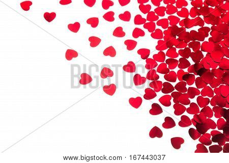 Valentine's day decorative border of red hearts confetti isolated on white background. Festive valentine backdrop.