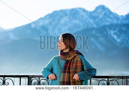 Portrait Of A Young Redhead Woman With Mountains On Background