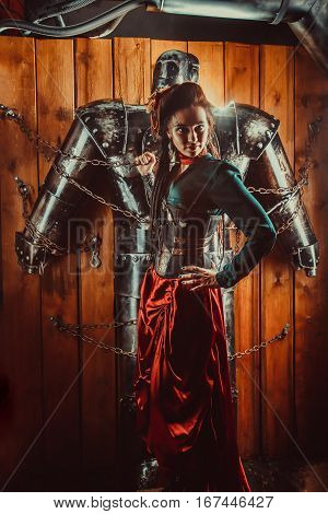 A Beautiful Woman With The Tied Male Robot.
