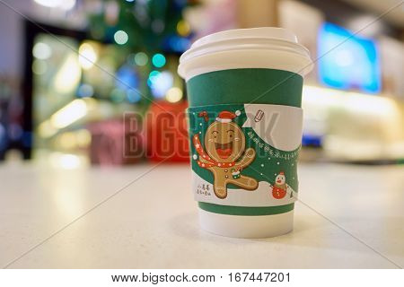 SHENZHEN, CHINA - CIRCA DECEMBER, 2016: McDonald's holday cup at McCafe in Shenzhen. McCafe is a coffee-house-style food and drink chain, owned by McDonald's.