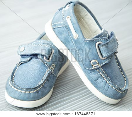 Children's moccasins. Beautiful and treading shoes. Boots for baby