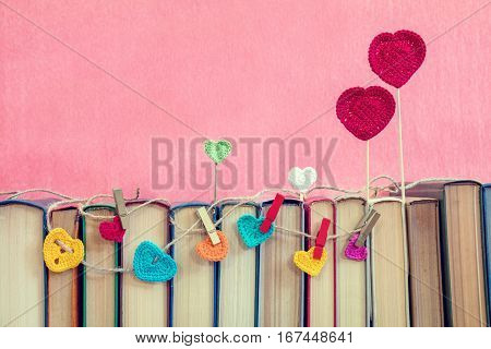 Many Multicolor Crochet Hearts On Books