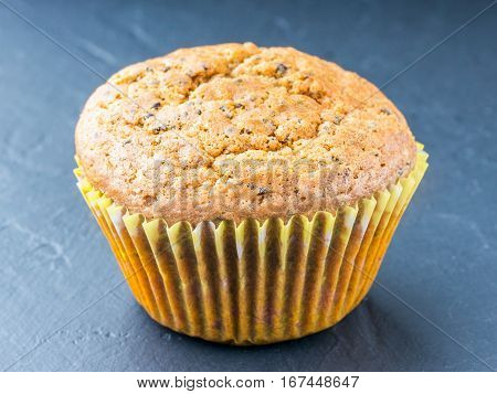 Muffin with chia seeds and lemon. Homemade muffin on black background
