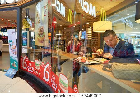 SHENZHEN, CHINA - CIRCA JANUARY, 2017: people eat at McDonald's restaurant in ShenZhen. McDonald's is an American hamburger and fast food restaurant chain.