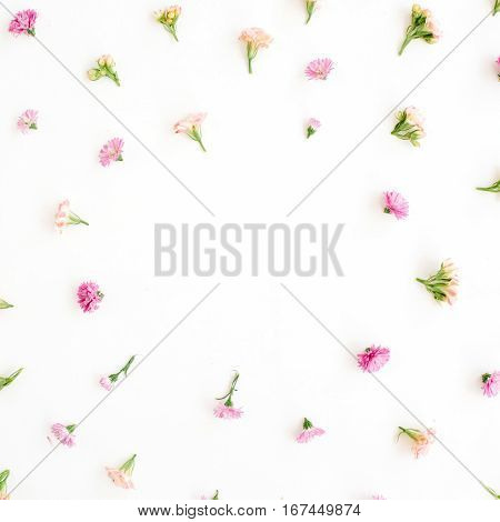 Frame with pink and beige wildflower buds green leaves branches on white background. Flat lay top view. Valentine's background