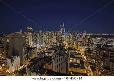 San Francisco, California, USA - January 13, 2017:  Night skyline view of streets and towers in downtown San Francisco.