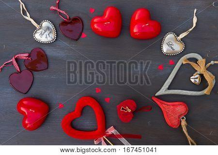 Valentines day hearts frame on dark wooden background