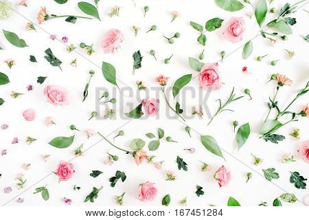 Floral pattern made of pink and beige roses green leaves branches on white background. Flat lay top view. Valentine's background