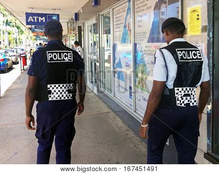 Fijian Police Officers Patrolling In The Main Street