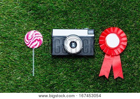 Red Reward And Vintage Camera With Lollipop
