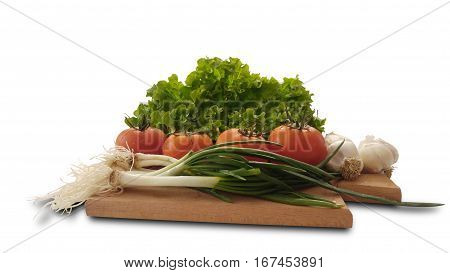 isolated tomatoes, lettuce, garlic and fresh salad onion