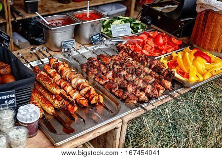 Barbecue Roasted Meat Shish Kebabs With Pepper and Onions On The Hot Grill. Good Snack For Outdoor Autumn Barbecue Party Or Picnic