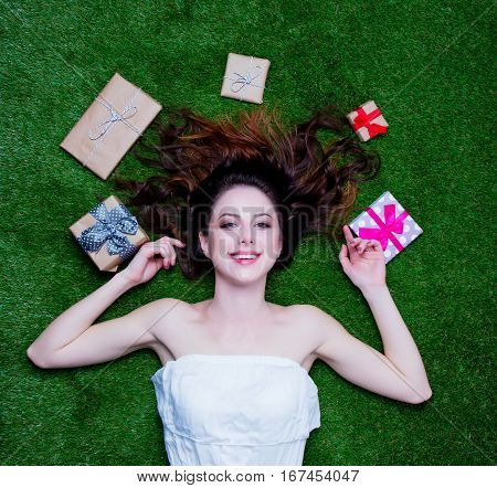Portrait Of A Young Redhead Woman With Holiday Gifts