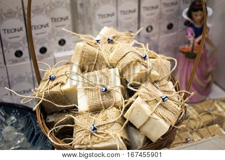 Collection of bars of fragrant hand made organic soap in a basket