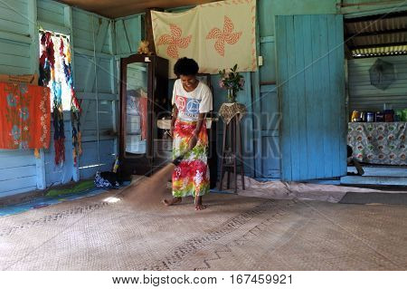 Indigenous Fijian Woman Cleans Her Home In Fiji